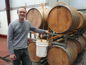 Jamie with some wonderfully happy aging casks of beer